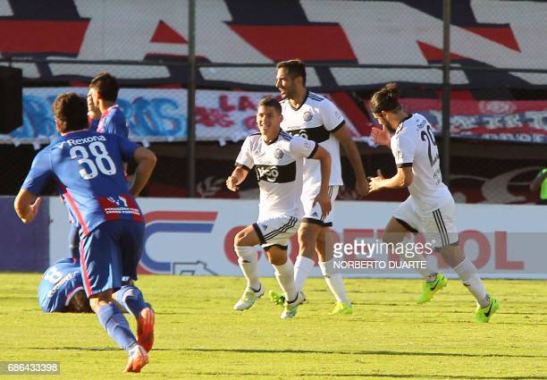 Olimpia's players celebrates after scoring against Cerro Porteno during their Paraguayan Apertura 2017 tournament match at the Defensores del Chaco...