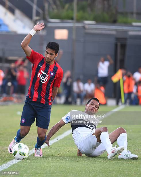 Olimpia's Salustiano Candia vies for the ball with Cecilio Dominguez of Cerro Porteno during their Paraguayan Clausura 2016 tournament football match...