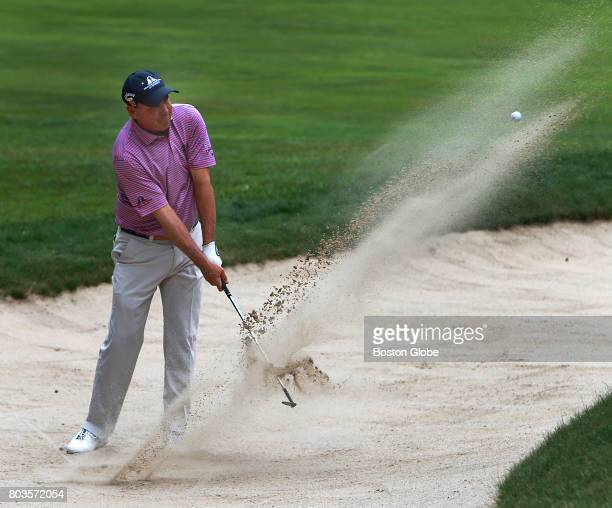 Olin Browne blasts out of a green side sand trap on the 2nd hole during the first round of the US Senior Open at the Salem Country Club in Peabody...