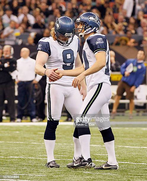 Olindo Mare and Jon Ryan of the Seattle Seahawks against the New Orleans Saints at Louisiana Superdome on November 21 2010 in New Orleans Louisiana