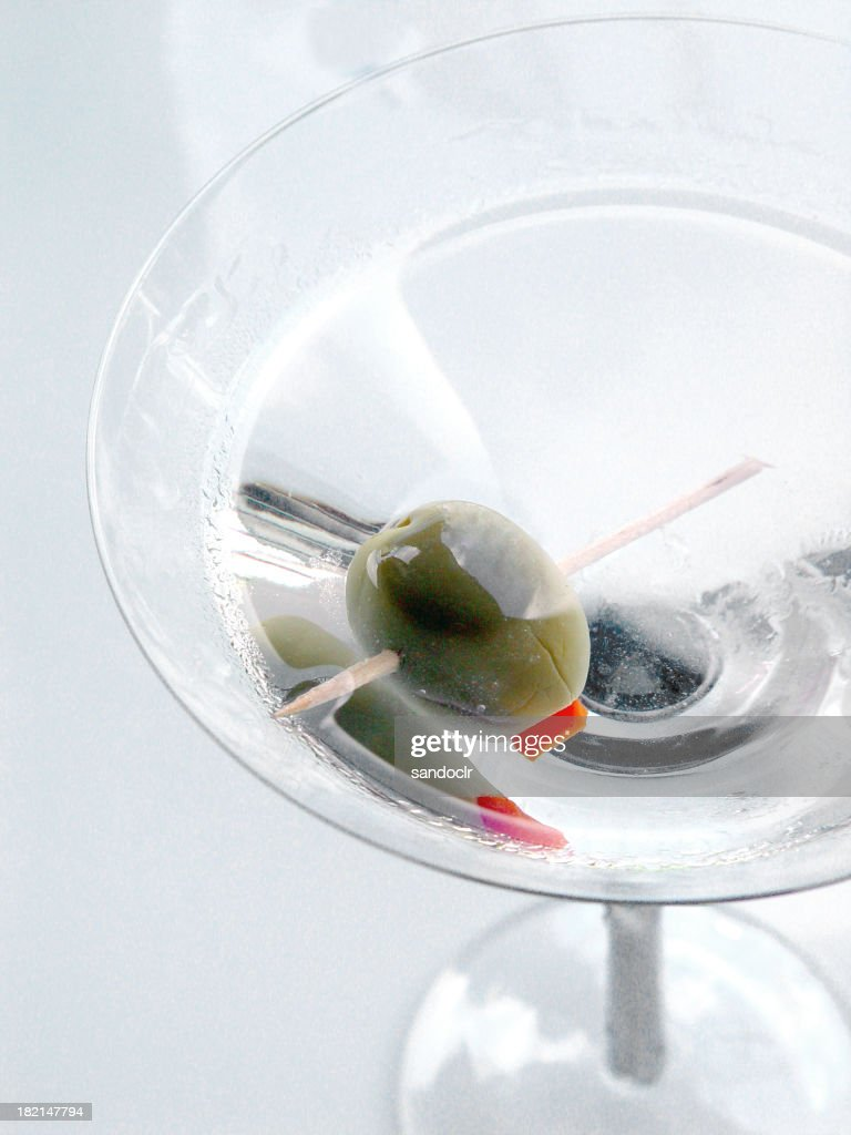 Olive in a martini : Stock Photo