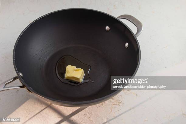 Olive oil and butter in a wok.
