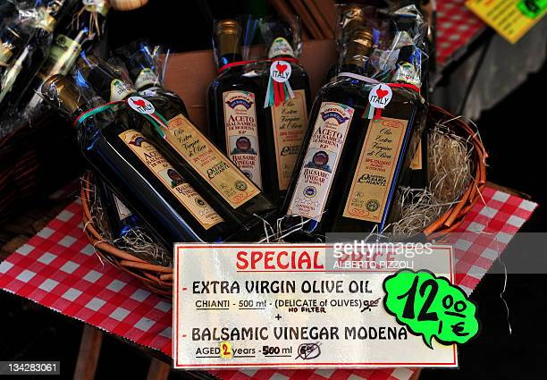 Olive oil and vinegar on sale are displayed in a street market in central Rome on November 30 2011 AFP PHOTO / ALBERTO PIZZOLI