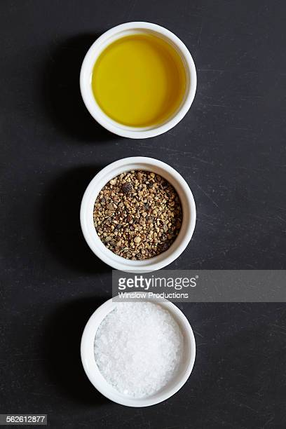 Olive oil, pepper and salt in ramekins