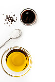 Olive oil, balsamic , salt and pepper on the white background vertical