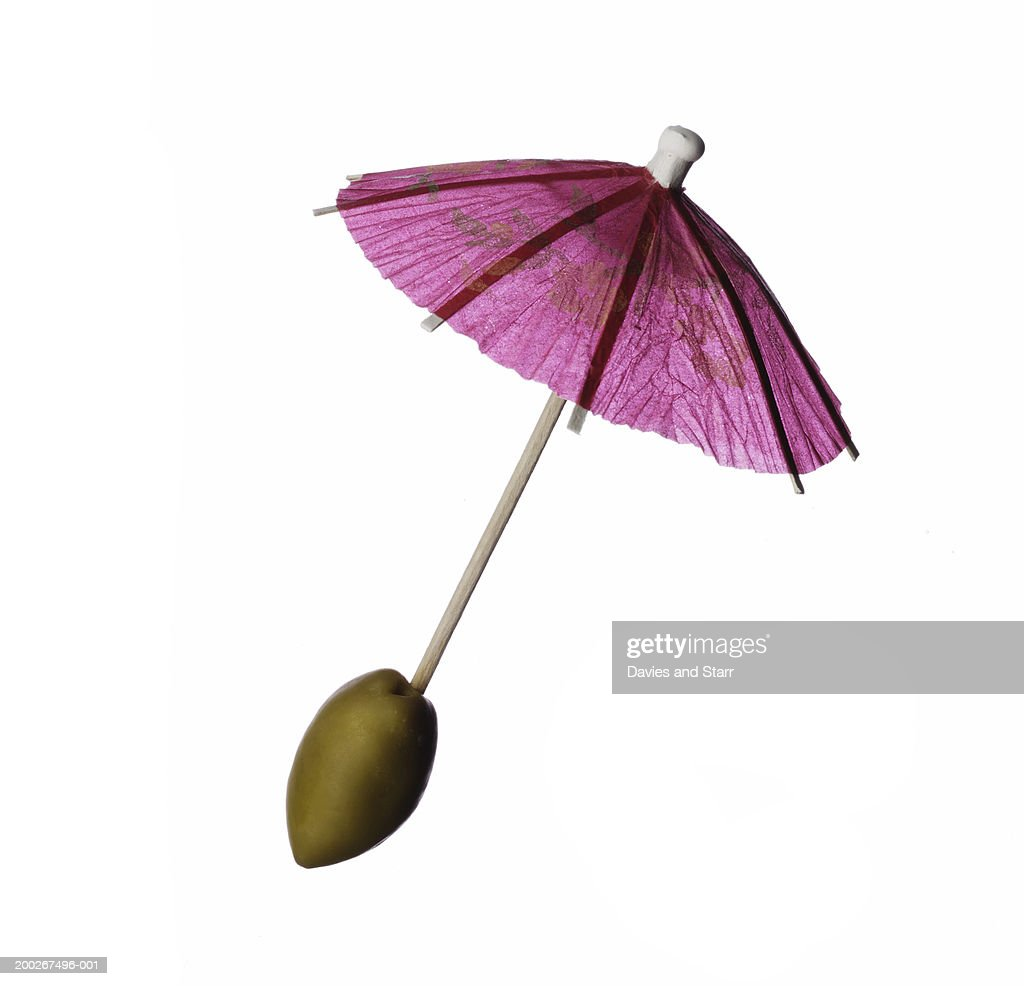 Olive on cocktail stirrer umbrella