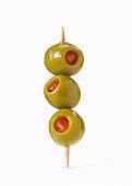 Three olives on toothpick