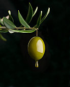 Olive with olive oil