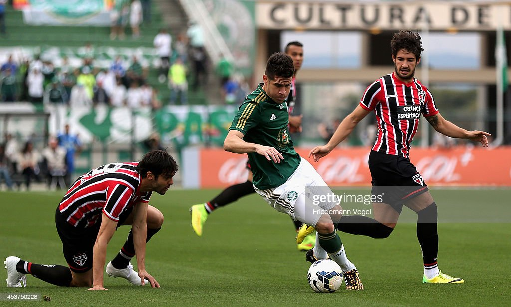 M. Oliveira (C) of Palmeiras fights for the ball with Kaka (L) and Pato (R) of Sao Paulo during the match between Palmeiras and Sao Paulo for the Brazilian Series A 2014 at Estadio do Pacaembu on August 17, 2014 in Sao Paulo, Brazil.