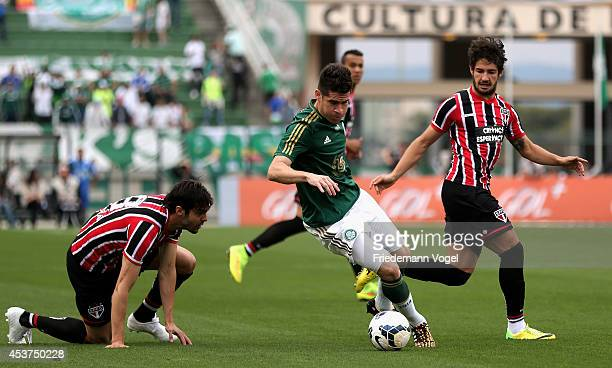 M Oliveira of Palmeiras fights for the ball with Kaka and Pato of Sao Paulo during the match between Palmeiras and Sao Paulo for the Brazilian Series...
