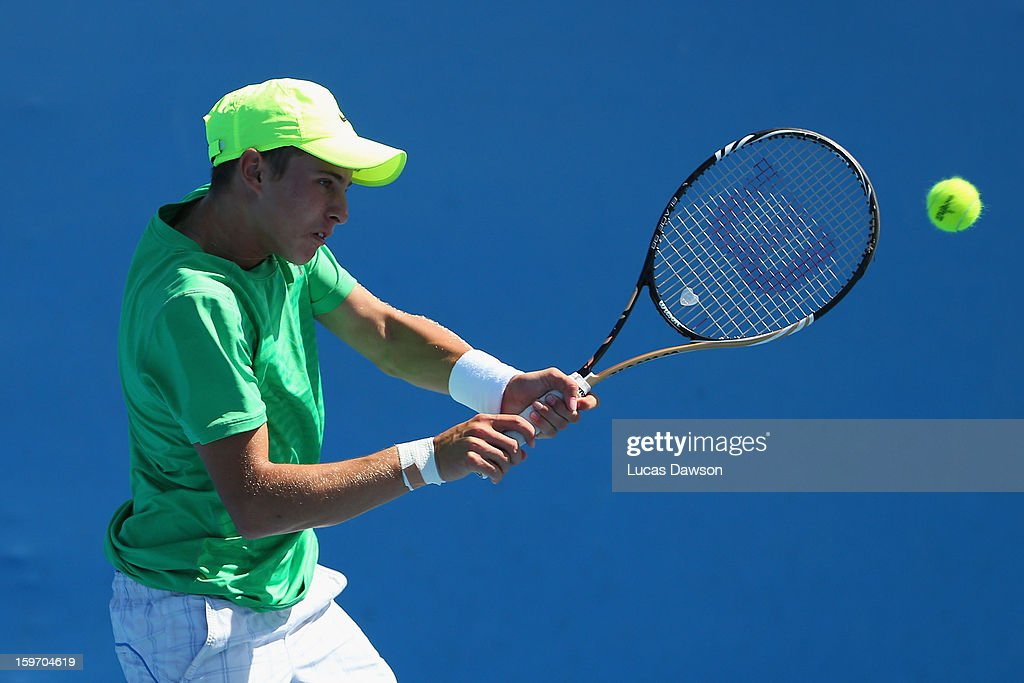 Oliver Anderson of Australia plays a backhand in his first round match against Brayden Schnur of Canada during the 2013 Australian Open Junior Championships at Melbourne Park on January 19, 2013 in Melbourne, Australia.