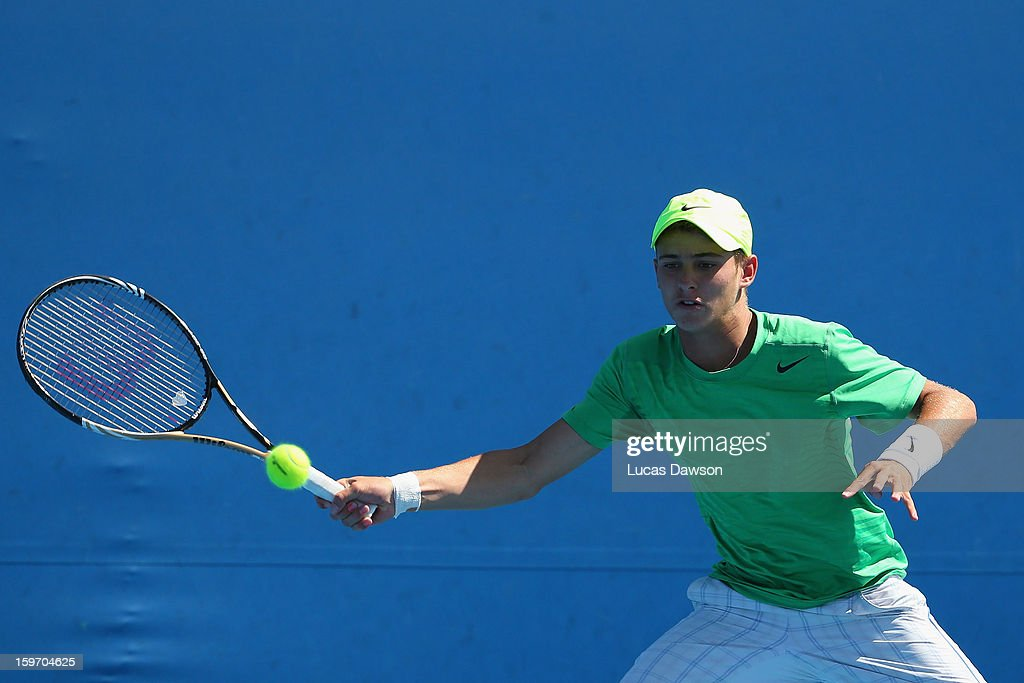 Oliver Anderson of Australia plays a forehand in his first round match against Brayden Schnur of Canada during the 2013 Australian Open Junior Championships at Melbourne Park on January 19, 2013 in Melbourne, Australia.