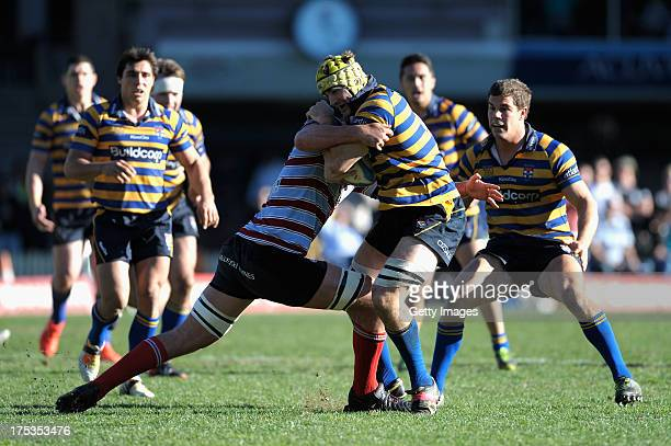 Oliver Atkins of Southern Districts is tackled during the round 16 Shute Shield match between Sydney Uni and Southern Districts at North Sydney Oval...