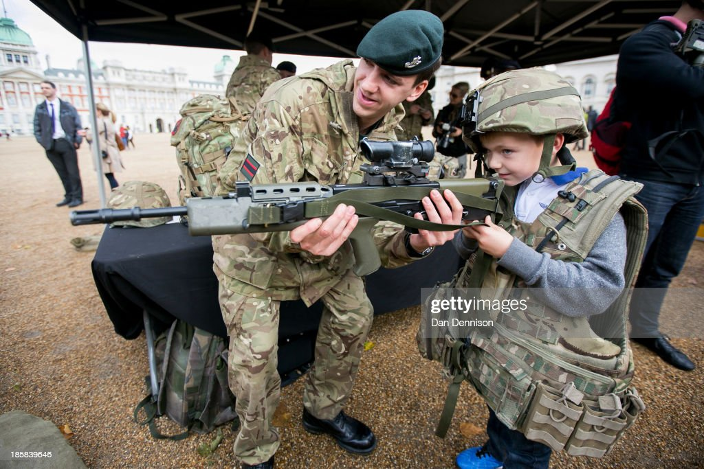 Oliver Baker, age 6, dresses up as a soldier during a Territorial Army recruitment day on October 25, 2013 in London, England. The recruitment day sees TA units from the Greater London area getting together for a one-off, interactive experience that will demonstrate their wide-ranging skills and capabilities.