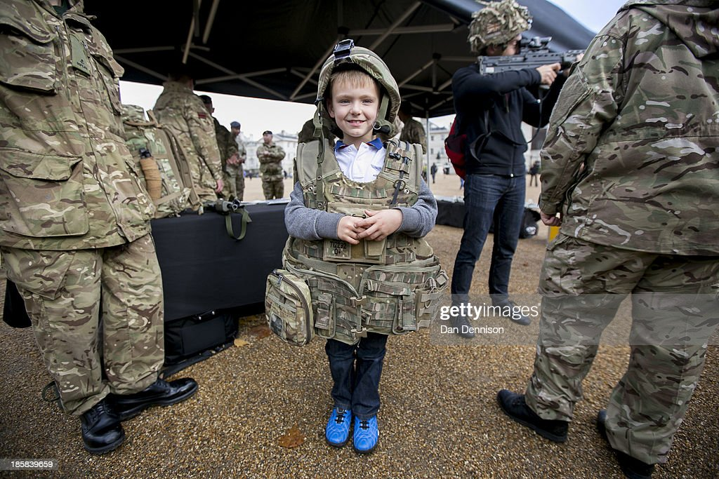 Oliver Baker, age 6, tries on a Kevlar jacket during a Territorial Army recruitment day on October 25, 2013 in London, England. The recruitment day sees TA units from the Greater London area getting together for a one-off, interactive experience that will demonstrate their wide-ranging skills and capabilities.
