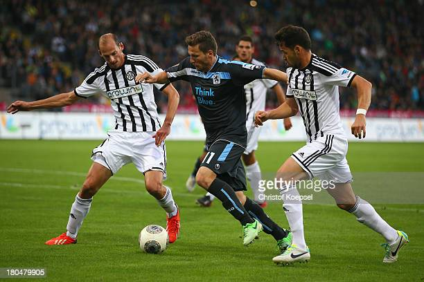 Oliver Barth of Aalen and Sascha Traut of Aalen challenge Benjamin Lauth of Muenchen during the Second Bundesliga match between VfR Aalen and 1860...