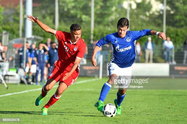Oliver Batista Meier of Bayern Muenchen and Andriko Smolinski of Schalke 04 compete for the ball during the B Juniors German Championship Semi Final...