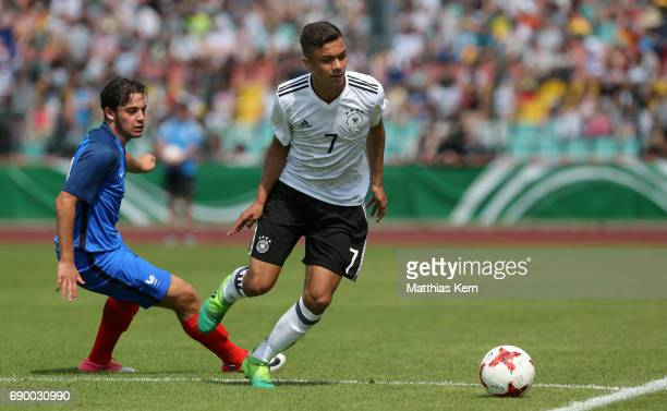 Oliver Batista Meier of Germany battles for the ball with Bilel Hassaini of France during the U16 international friendly match between Germany and...