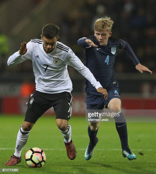 Oliver Batista Meier of Germany holds off Thomas Doyle of England during the International Match between England U17 and Germany U17 at The New York...