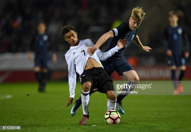 Oliver Batista Meier of Germany is tackled by Thomas Doyle of England during the International Match between England U17 and Germany U17 at The New...