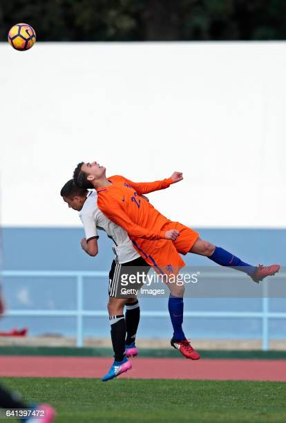 Oliver BatistaMeier of Germany U16 challenges Enric Llansana of Netherlands U16 during the UEFA Development Tournament Match between Germany U16 and...