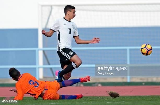 Oliver BatistaMeier of Germany U16 challenges Shurandy Sambo of Netherlands U16 during the UEFA Development Tournament Match between Germany U16 and...