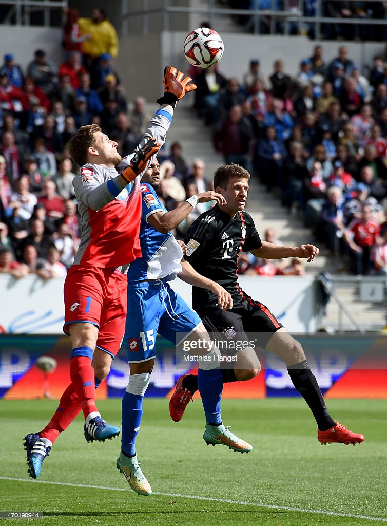 <a gi-track='captionPersonalityLinkClicked' href=/galleries/search?phrase=Oliver+Baumann&family=editorial&specificpeople=4645207 ng-click='$event.stopPropagation()'>Oliver Baumann</a> (L), goalkeeper of Hoffenheim makes a save on <a gi-track='captionPersonalityLinkClicked' href=/galleries/search?phrase=Thomas+Mueller&family=editorial&specificpeople=5842906 ng-click='$event.stopPropagation()'>Thomas Mueller</a> (R) of Muenchen during the Bundesliga match between 1899 Hoffenheim and FC Bayern Muenchen at Wirsol Rhein-Neckar-Arena on April 18, 2015 in Sinsheim, Germany.