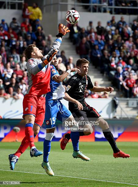Oliver Baumann goalkeeper of Hoffenheim makes a save on Thomas Mueller of Muenchen during the Bundesliga match between 1899 Hoffenheim and FC Bayern...