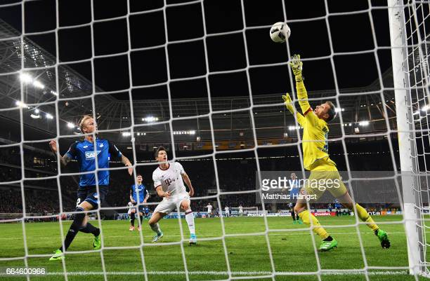 Oliver Baumann of 1899 Hoffenheim saves a shot at goal from Robert Lewandowski of Bayern Munich during the Bundesliga match between TSG 1899...
