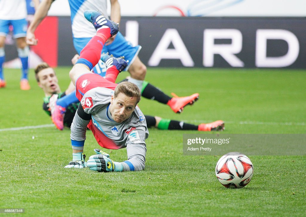 <a gi-track='captionPersonalityLinkClicked' href=/galleries/search?phrase=Oliver+Baumann&family=editorial&specificpeople=4645207 ng-click='$event.stopPropagation()'>Oliver Baumann</a> of 1899 Hoffenheim watches as <a gi-track='captionPersonalityLinkClicked' href=/galleries/search?phrase=Patrick+Herrmann+-+German+Soccer+Player+-+Born+1991&family=editorial&specificpeople=9785559 ng-click='$event.stopPropagation()'>Patrick Herrmann</a> of Borussia Moenchengladbach scores a goal during the Bundesliga match between 1899 Hoffenheim and Borussia Moenchengladbach at Wirsol Rhein-Neckar-Arena on April 4, 2015 in Sinsheim, Germany.