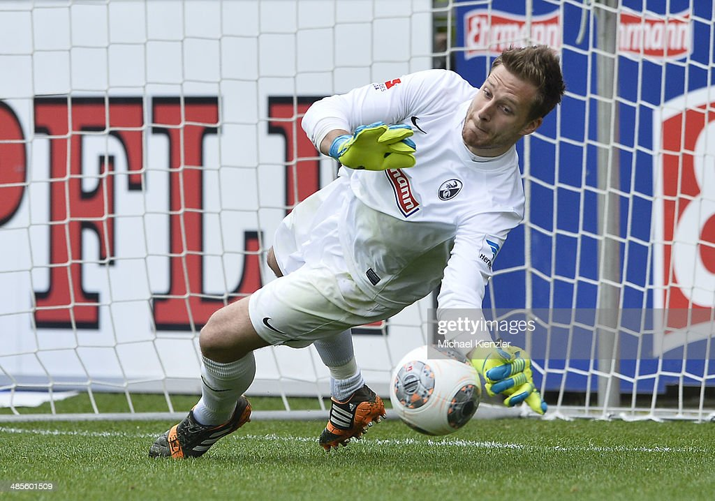 Oliver Baumann of Freiburg catches a penalty during the Bundesliga match between SC Freiburg and Borussia Moenchengladbach at Mage Solar Stadium on April 19, 2014 in Freiburg, Germany.