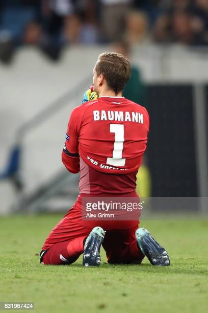 Oliver Baumann of Hoffenheim on his knees during the UEFA Champions League Qualifying PlayOffs Round First Leg match between 1899 Hoffenheim and...