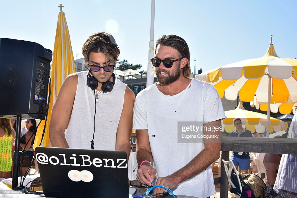 Oliver Benz and Eden Saul attend the NYMag + San Pellegrino Beach Party at Gurney's Montauk Resort and Seawater Spa on June 25, 2016 in Montauk, New York.