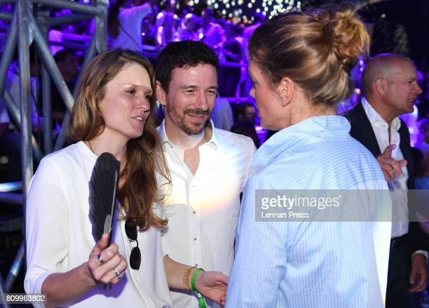 Oliver Berben his wife Katrin Berben and Marie Baeumer attend the fashion show during the 50th anniversary celebration of Marc O'Polo at its...