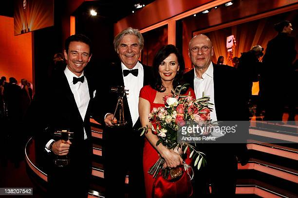 Oliver Berben poses with his Goldene Kamera Best TV Movie National award for the movie 'Liebesjahre' next to his mother Iris Berben and Peter...