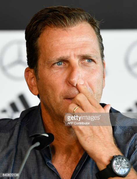 Oliver Bierhoff manager of the German national football team attends a press conference in Stuttgart southwestern Germany on August 30 ahead of the...