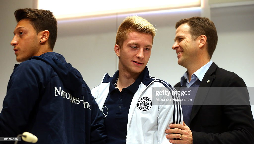 Oliver Bierhoff (R), manager of the German national team smiles with his players Mesut Oezil (L) and Marco Reus during a during a press conference of the German national football team at adidas World of Sports, Brand Center on March 24, 2013 in Herzogenaurach, Germany.