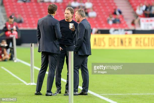 Oliver Bierhoff of Germany cocoach Marcus Sorg of Germany and Andreas Koepke of Germany looks on during the FIFA 2018 World Cup Qualifier between...