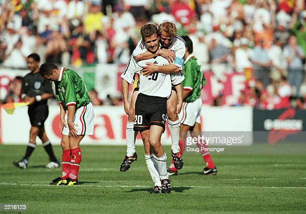 Oliver Bierhoff of Germany is congratulated by teammate Jurgen Klinsmann after scoring the winning goal during the FIFA World Cup Finals 1998 Second...