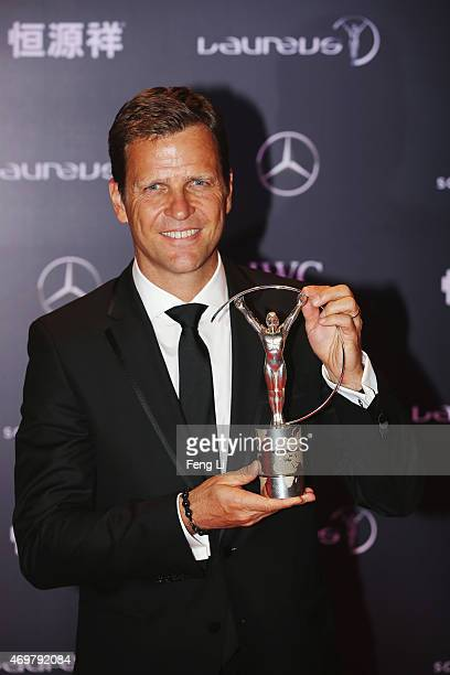 Oliver Bierhoff Team Manager of the German National Football Team poses with the Team of the Year Award on behalf of the German National Football...