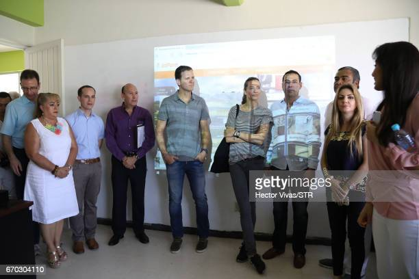 Oliver Bierhoff team manager of the German national team and Klara Bierhoff listen an explanation during the visit and unveiling of plaque for the...