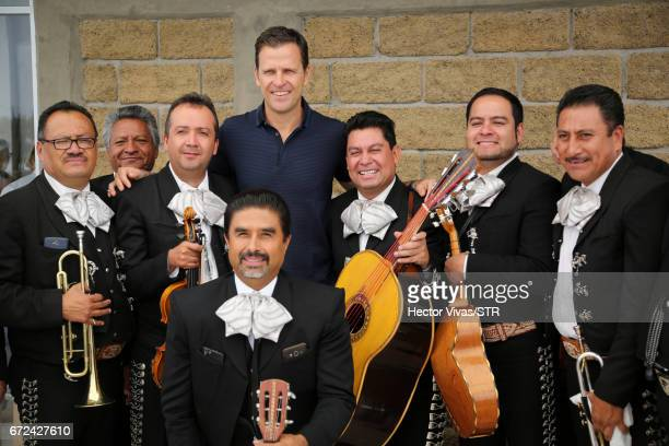 Oliver Bierhoff team manager of the German national team pose with mexican mariachis during the visit and unveiling of plaque for the economic...