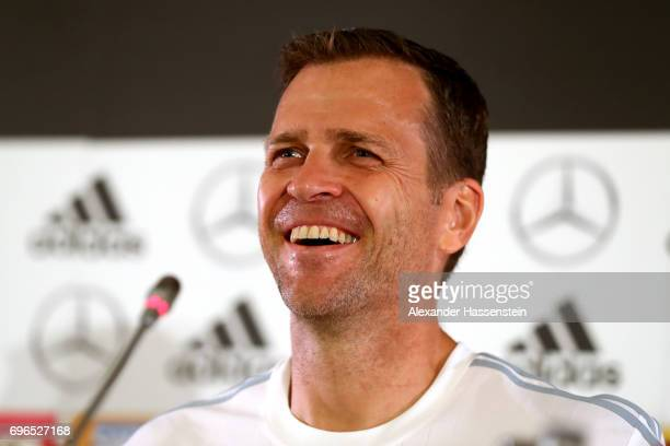 Oliver Bierhoff team manager of the German national team smiles during a Press Conference of the German national team at Radisson Blu Paradise Resort...