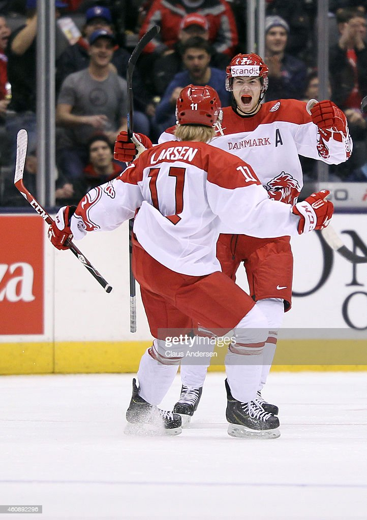 Oliver Bjorkstrand #27 of Team Denmark celebrates his tying goal against Team Czech Republic during the 2015 IIHF World Junior Hockey Championship at the Air Canada Centre on December 29, 2014 in Toronto, Ontario, Canada.