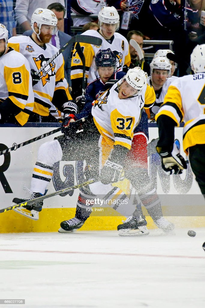 Oliver Bjorkstrand #28 of the Columbus Blue Jackets and Carter Rowney #37 of the Pittsburgh Penguins battle for control of the puck during the third period of Game Three of the Eastern Conference First Round during the 2017 NHL Stanley Cup Playoffs on April 16, 2017 at Nationwide Arena in Columbus, Ohio. Pittsburgh defeated Columbus 5-4 in overtime. Pittsburgh leads the series 3-0.