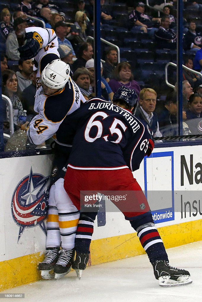 Oliver Bjorkstrand #65 of the Columbus Blue Jackets checks Brayden McNabb #44 of the Buffalo Sabres while battling for control of the puck on September, 2013 at Nationwide Arena in Columbus, Ohio. Buffalo defeated Columbus 3-1.