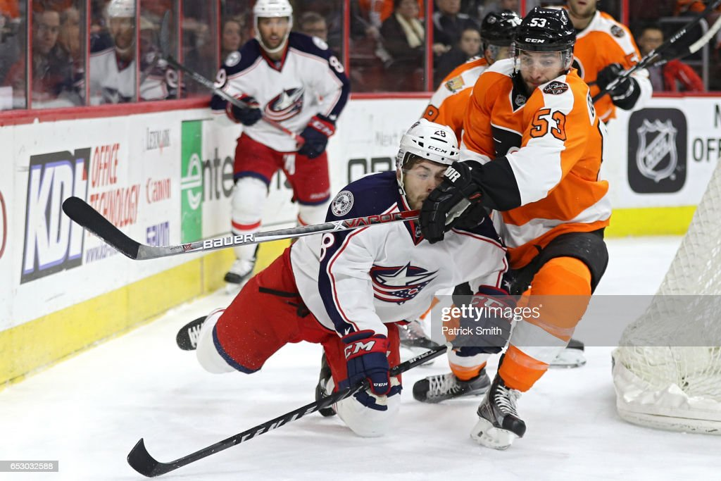 Oliver Bjorkstrand #28 of the Columbus Blue Jackets is checked by Shayne Gostisbehere #53 of the Philadelphia Flyers during the first period at Wells Fargo Center on March 13, 2017 in Philadelphia, Pennsylvania.