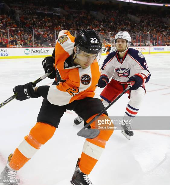Oliver Bjorkstrand of the Columbus Blue Jackets moves in to check Brandon Manning of the Philadelphia Flyers during the first period at the Wells...