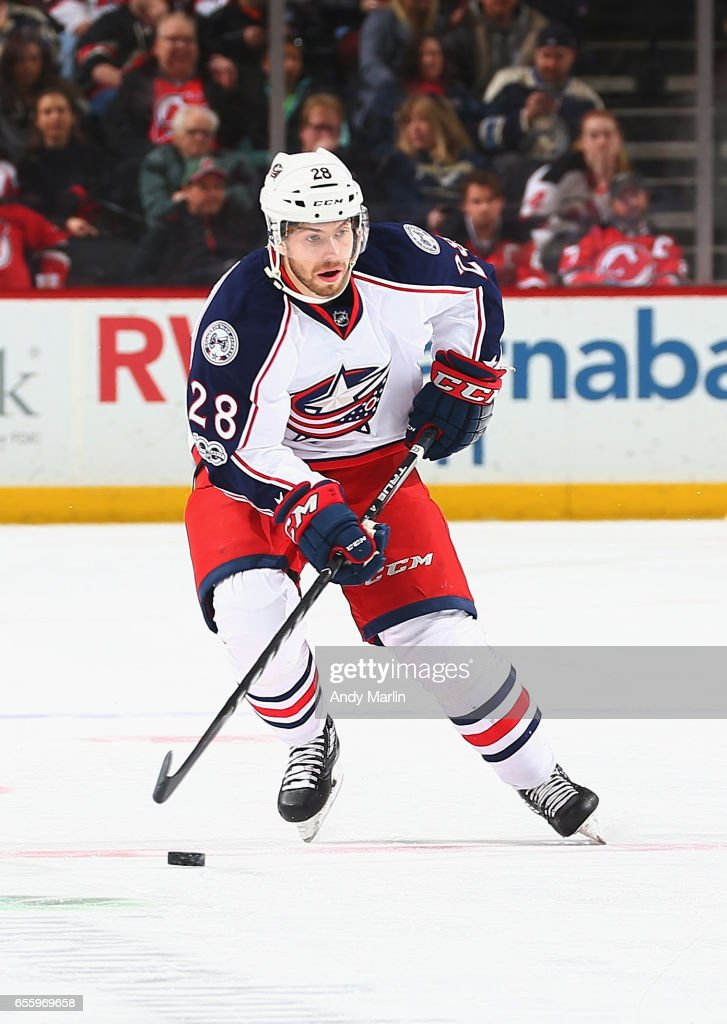 Oliver Bjorkstrand #28 of the Columbus Blue Jackets plays the puck against the New Jersey Devils during the game at Prudential Center on March 19, 2017 in Newark, New Jersey.