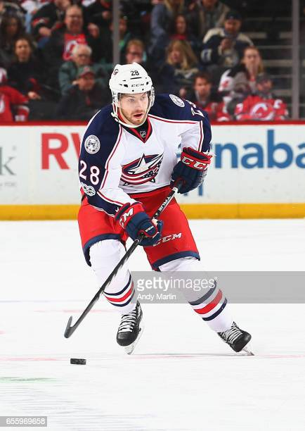 Oliver Bjorkstrand of the Columbus Blue Jackets plays the puck against the New Jersey Devils during the game at Prudential Center on March 19 2017 in...